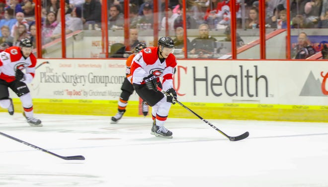 Jordan Sims takes the puck up the ice in Cincinnati's first game of the season.