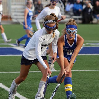 SCD's Caroline Kubicki [right] gets control of the ball away from MND's Kate Cook in the game between the Summit Country Day Silver Knights and the Mount Notre Dame Cougars at MND High School. MND defeated SCD 8-0.