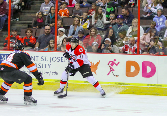Jordan Sims controls the puck against the Fort Wayne Komets.