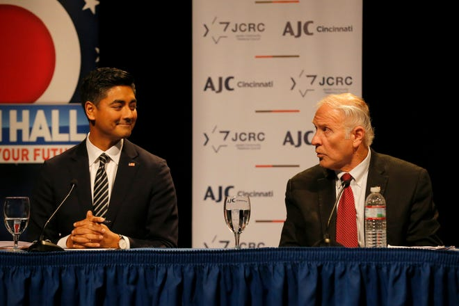 Democratic candidate, Hamilton County Clerk, Aftab Pureval smiles as he listens to an answer from Republican incumbent, U.S. Rep,. Steve Chabot during a debate forum for the first and second congressional districts of Ohio hosted by AJC Cincinnati at the Mayerson Jewish Community Center in Amberly, Ohio, on Tuesday, Oct. 16, 2018.