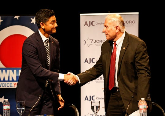 Democratic candidate, Hamilton County Clerk, Aftab Pureval and Republican incumbent, U.S. Rep,. Steve Chabot shakes hands at the conclusion of a debate forum for the first and second congressional districts of Ohio hosted by the Mayerson Jewish Community Center in Amberly, Ohio, on Tuesday, Oct. 16, 2018.