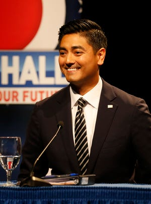 Democratic candidate, Hamilton County Clerk, Aftab Pureval smiles as the audience applauds at the end of the debate forum for the first and second congressional districts of Ohio hosted by the Mayerson Jewish Community Center in Amberly, Ohio, on Tuesday, Oct. 16, 2018.