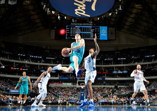J.P. Macura #55 of the Charlotte Hornets drives to the basket against the Dallas Mavericks on October 12, 2018 at the American Airlines Center in Dallas, Texas.