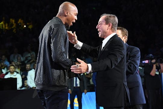 David West receives his 2018 NBA finals Championship ring from Owner Joseph S. Jacob on October 16, 2018 at ORACLE Arena in Oakland, California.
