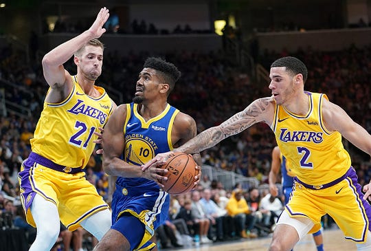 Jacob Evans #10 of the Golden State Warriors drives on Travis Wear #21 and has the ball slapped away by Lonzo Ball #2 of the Los Angeles Lakers during the second half of their NBA basketball game at SAP Center on October 12, 2018 in San Jose, California.