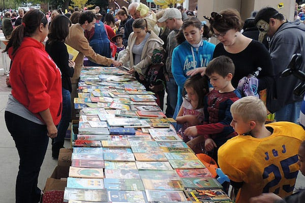 Children look through books at a previous Candy For the Mind event.