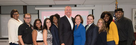 In the center of the photo is New Jersey Governor Phil Murphy, with New Jersey Secretary of Higher Education Zakiya Smith Ellis (left) and Dr. McMenamin (right), and Union students.