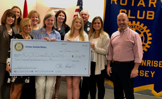 Representatives on hand for the check presentation were Gina Carro and Kristen Letkus of the Cancer Support Community of Central New Jersey, Tracey DePano from the American Cancer Society, Dina Marron, advisor for the North Hunterdon Interact Club; Alyssa Katyan, Ashleann Berry and Hannah Mitchell, seniors, North Hunterdon High School Interact Club; Captain Steve Bardecker from the Clinton Fire & Rescue Squad; Lynn Arnold, Rotarian and organizer of the Club's Ducky Race and Chris Knoll, president 2018-19 for The Rotary Club of Clinton Sunrise.