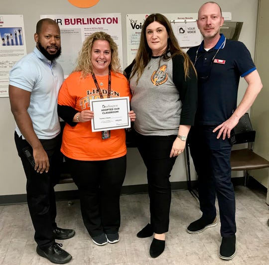 Linden School No. 5 first-grade teacher Marissa Scorese is honored at the Burlington store in Linden. Pictured are Burlington Assistant Manager Jammie Crudup, Scorese, School No. 5 Principal Laura Scamardella, and Burlington Store Manager Tym Hanson.