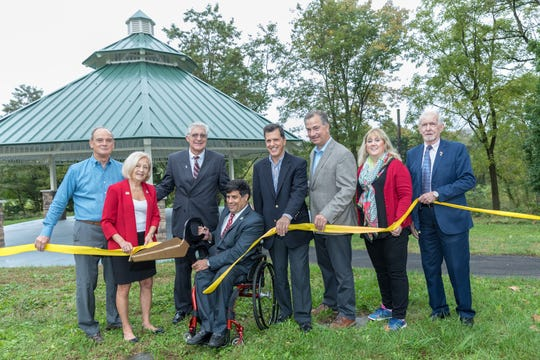 Cutting the ribbon to officially open the two new pavilions at East County Park in Warren Township are (left to right): Former Park Commission PresidentGov. Don DiFrancesco;Freeholder Patricia Walsh;Warren Township Mayor Vic Sordillo;Freeholder Director Patrick Scaglione;Freeholder Mark Caliguire;Park Commission Interim Secretary-Director Geoffrey Soriano;Park Commission Deputy Director Cindie Sullivan;and Park Commission President Bill Crosby.