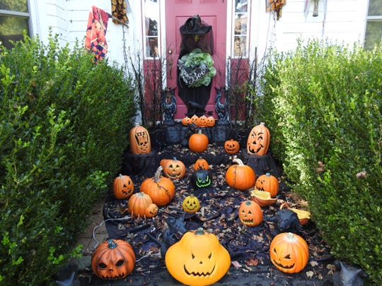 Pumpkins line the walk up to a witch at the front door of Shelly Lillibridge's home overlooking Roscoe Village.