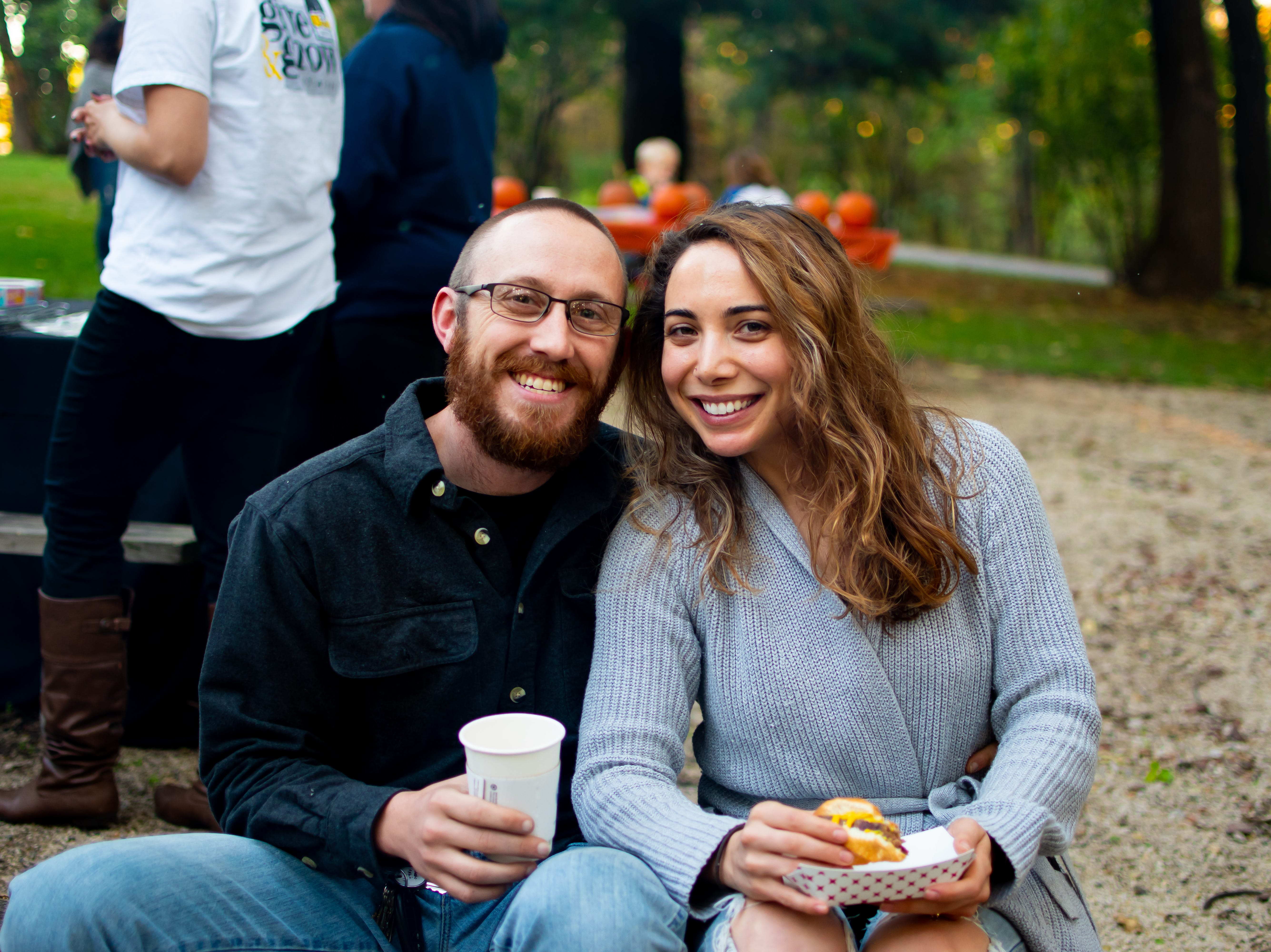 Tyler and Jasmine Gahagan, both of Texas, attend the Waukee Area Chamber of Commerce fall after hours party at Timberline Campground on Tuesday, Oct. 16, 2018 for in Waukee.