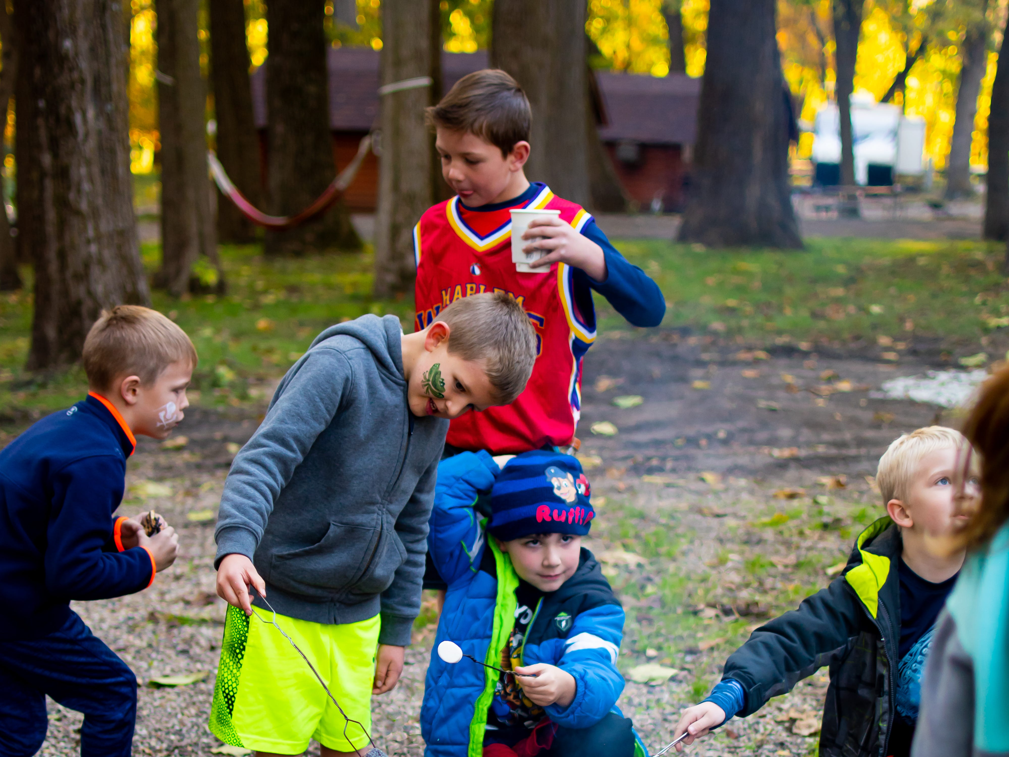 Kids enjoy making s'mores on Tuesday, Oct. 16, 2018 for the Waukee Area Chamber of Commerce fall after hours party at Timberline Campground in Waukee.