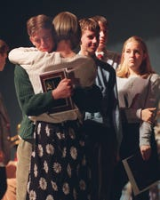April 8, 1998. Des Moines Christian School junior Steve Myers, 17, gets a hug from former WOI-TV reporter Kimberly Arms Wednesday. Behind them are J.D. Myers, 15, Phil Lockwood, 15, and Sadie Parker, 15.