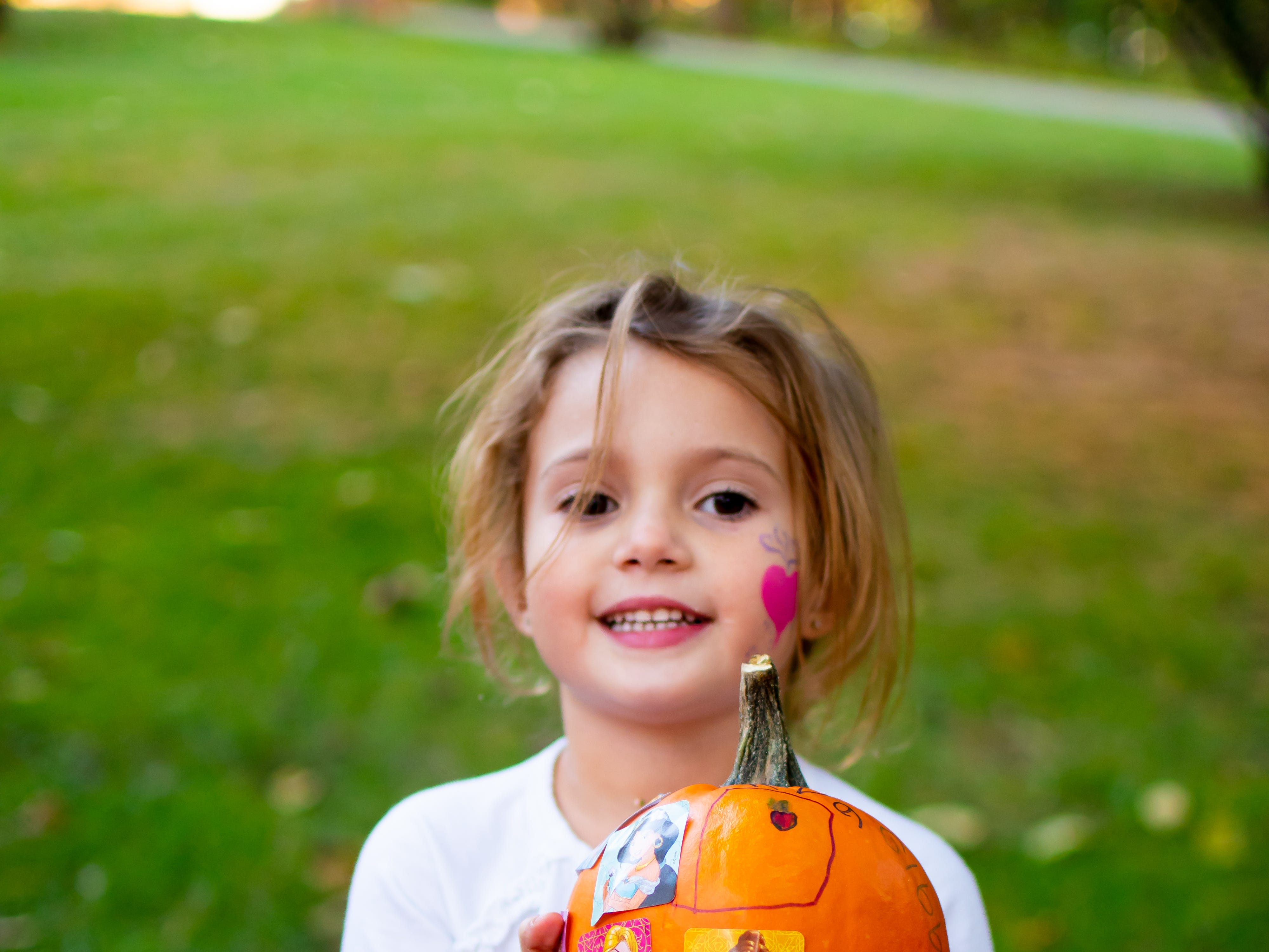 Ava Gibbons, 5, of West Des Moines decorates a pumpkin on Tuesday, Oct. 16, 2018 for the Waukee Area Chamber of Commerce fall after hours party at Timberline Campground in Waukee.