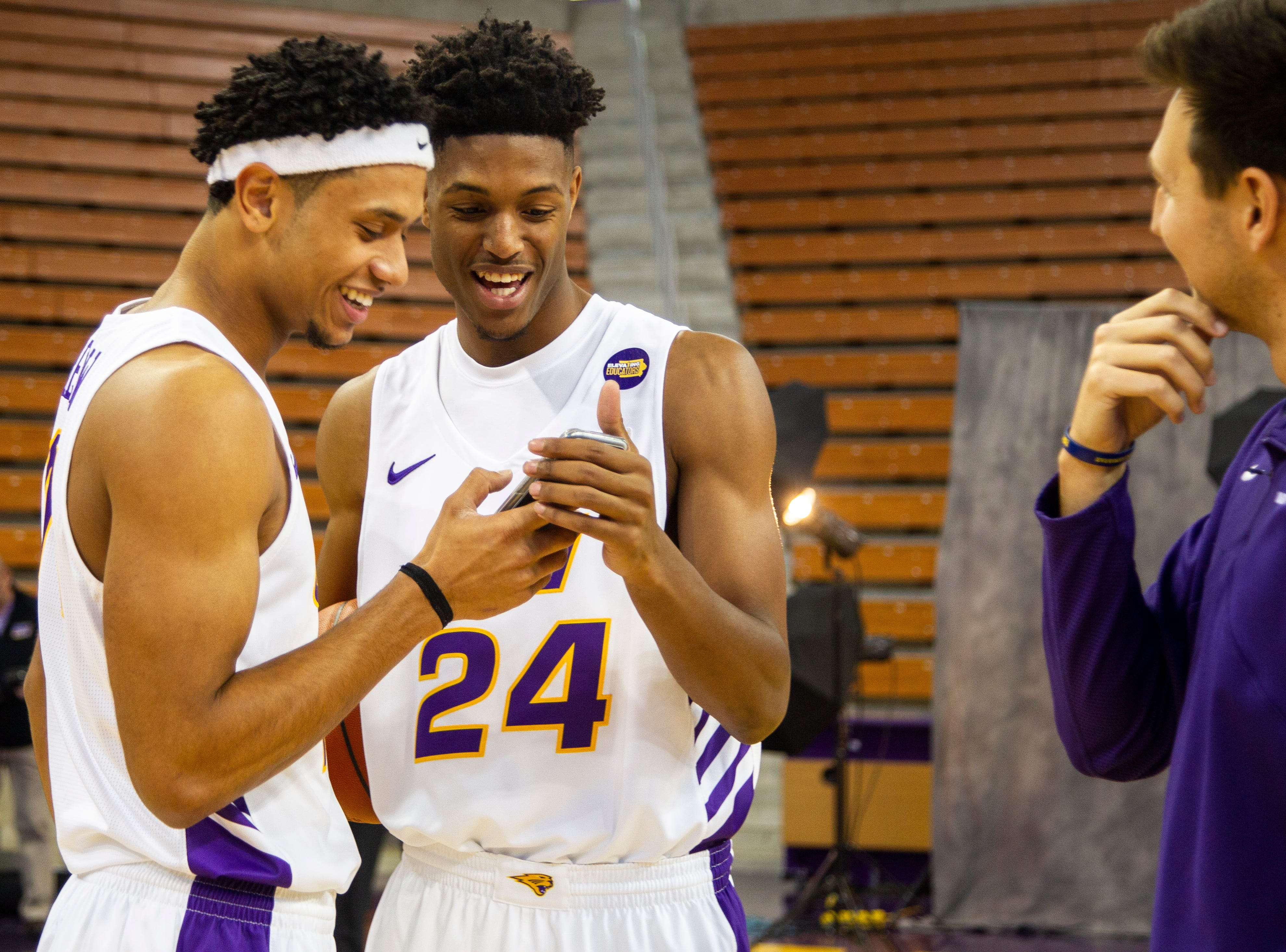Northern Iowa guard Isaiah Brown (24) looks at a photo with Trae Berhow (11) during Panthers men's basketball media day on Wednesday, Oct. 17, 2018, at the McLeod Center in Cedar Falls.