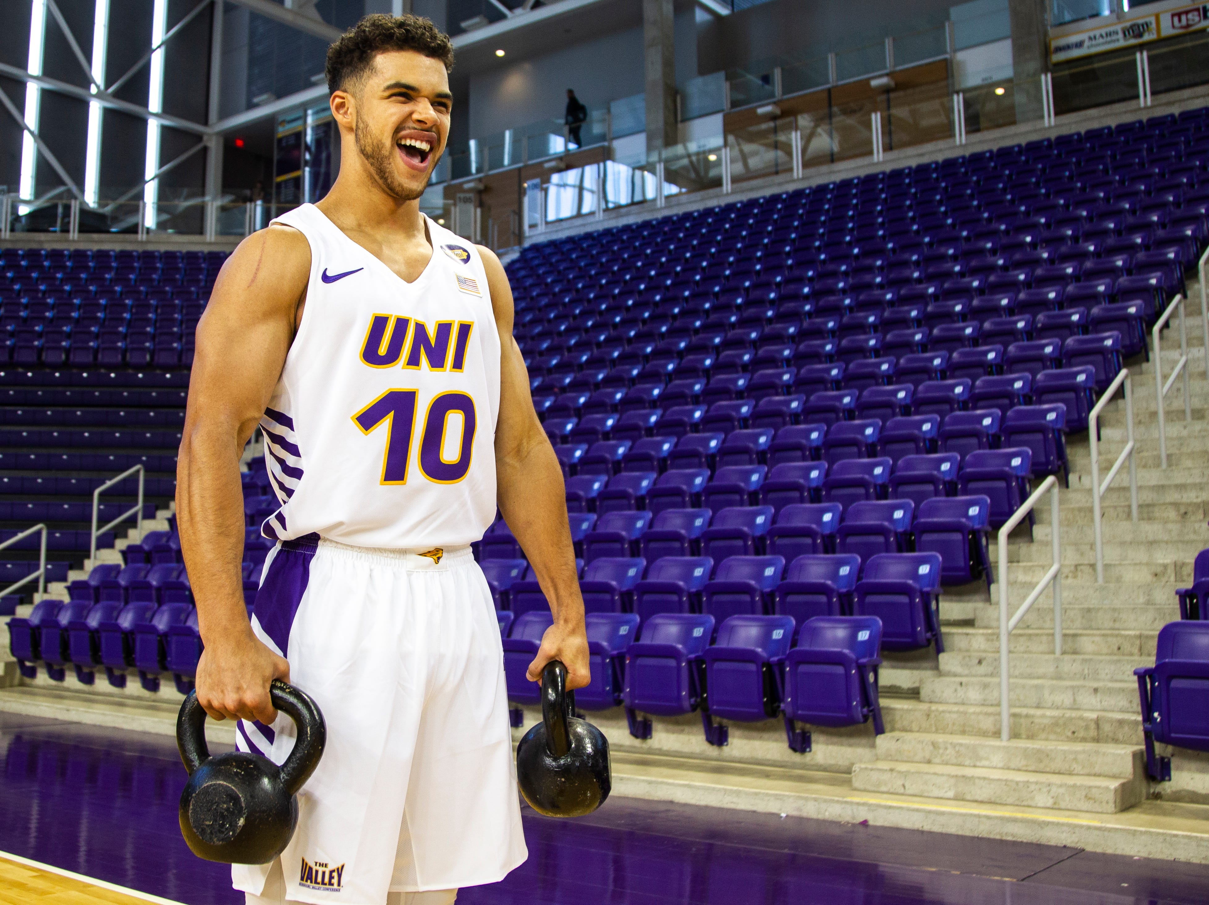 Northern Iowa guard Miles Wentzien (10) holds weights while having his photo taken during Panthers men's basketball media day on Wednesday, Oct. 17, 2018, at the McLeod Center in Cedar Falls.
