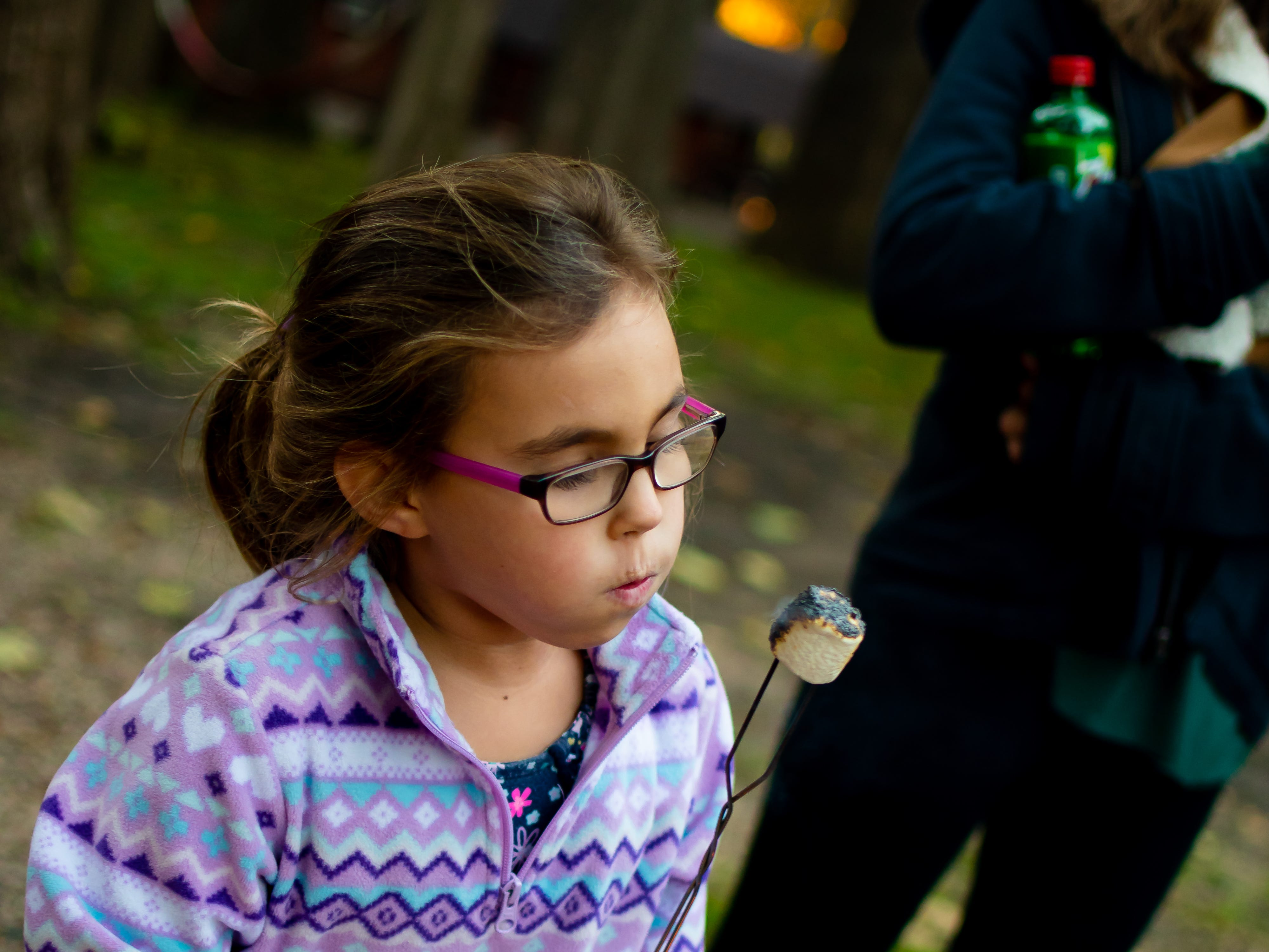 Avery Rowland, 6, of Waukee makes a s'more on Tuesday, Oct. 16, 2018 for the Waukee Area Chamber of Commerce fall after hours party at Timberline Campground in Waukee.