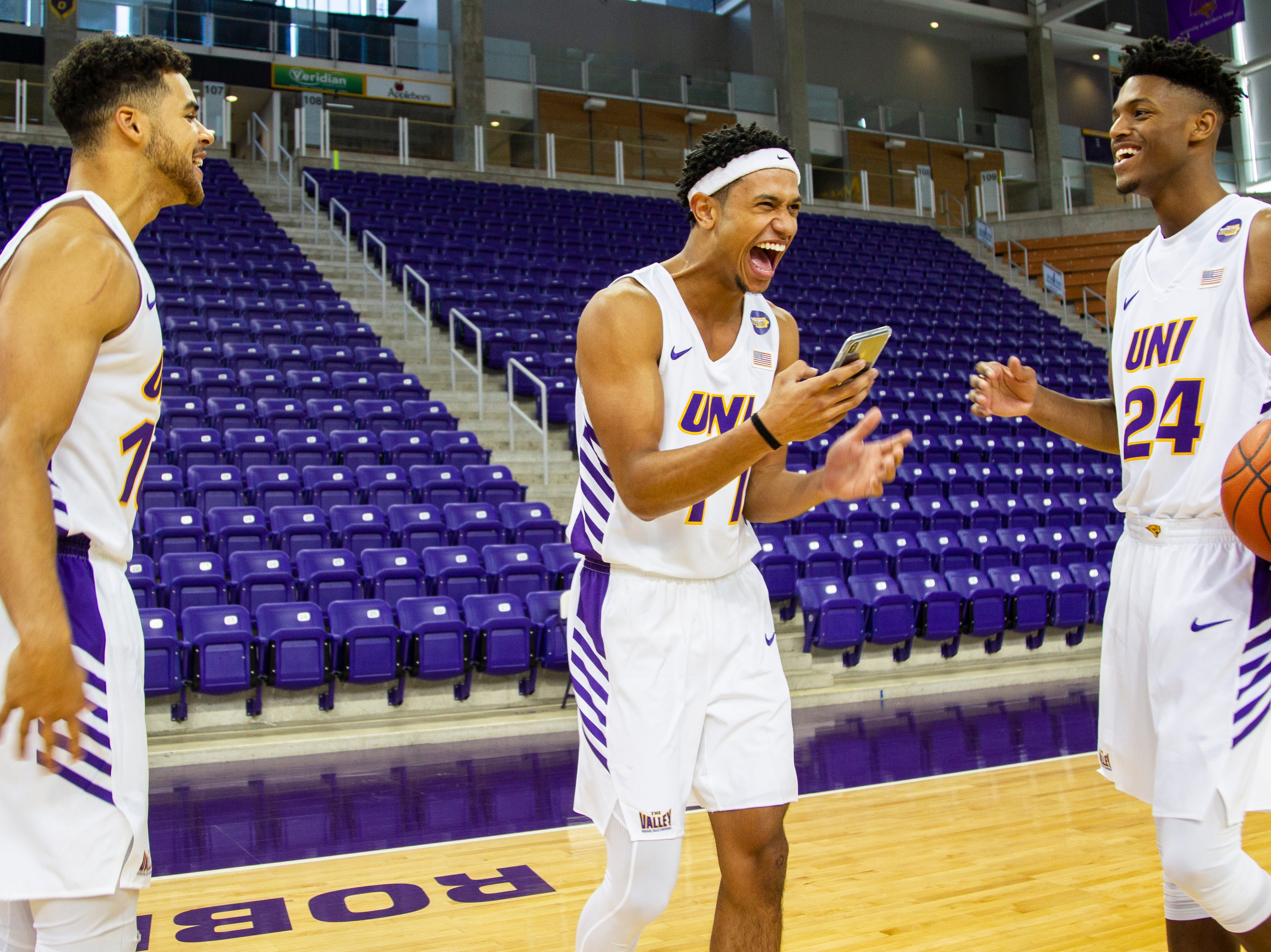 Northern Iowa guards Miles Wentzien (10) Trae Berhow (11) and Isaiah Brown (24) joke around during Panthers men's basketball media day on Wednesday, Oct. 17, 2018, at the McLeod Center in Cedar Falls.