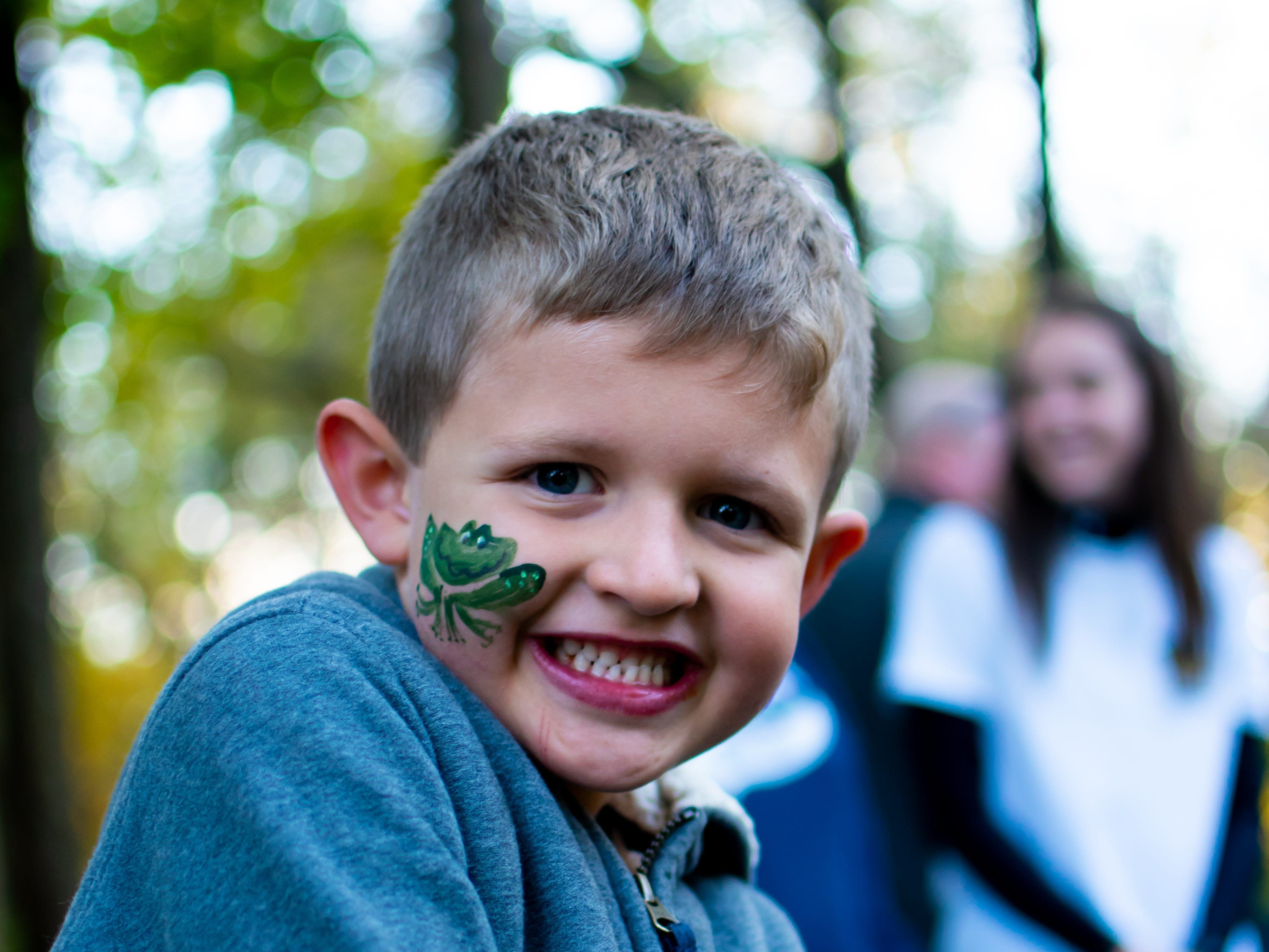 Grant Boaz, 6, of Waukee shows of the frog he received from a face painting session on Tuesday, Oct. 16, 2018 for the Waukee Area Chamber of Commerce fall after hours party at Timberline Campground in Waukee.