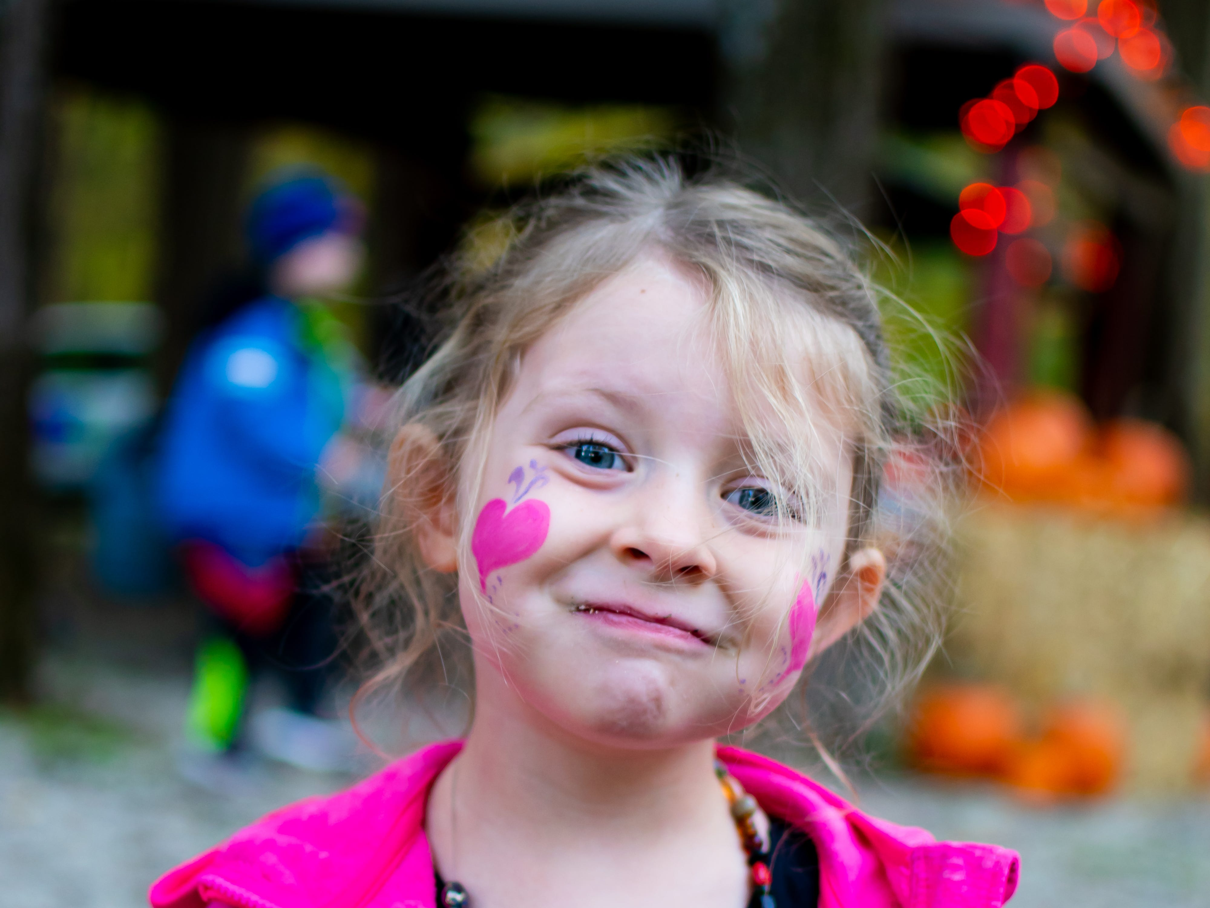 Leona Boaz, 3, of Waukee got her face painted on Tuesday, Oct. 16, 2018 for the Waukee Area Chamber of Commerce fall after hours party at Timberline Campground in Waukee.