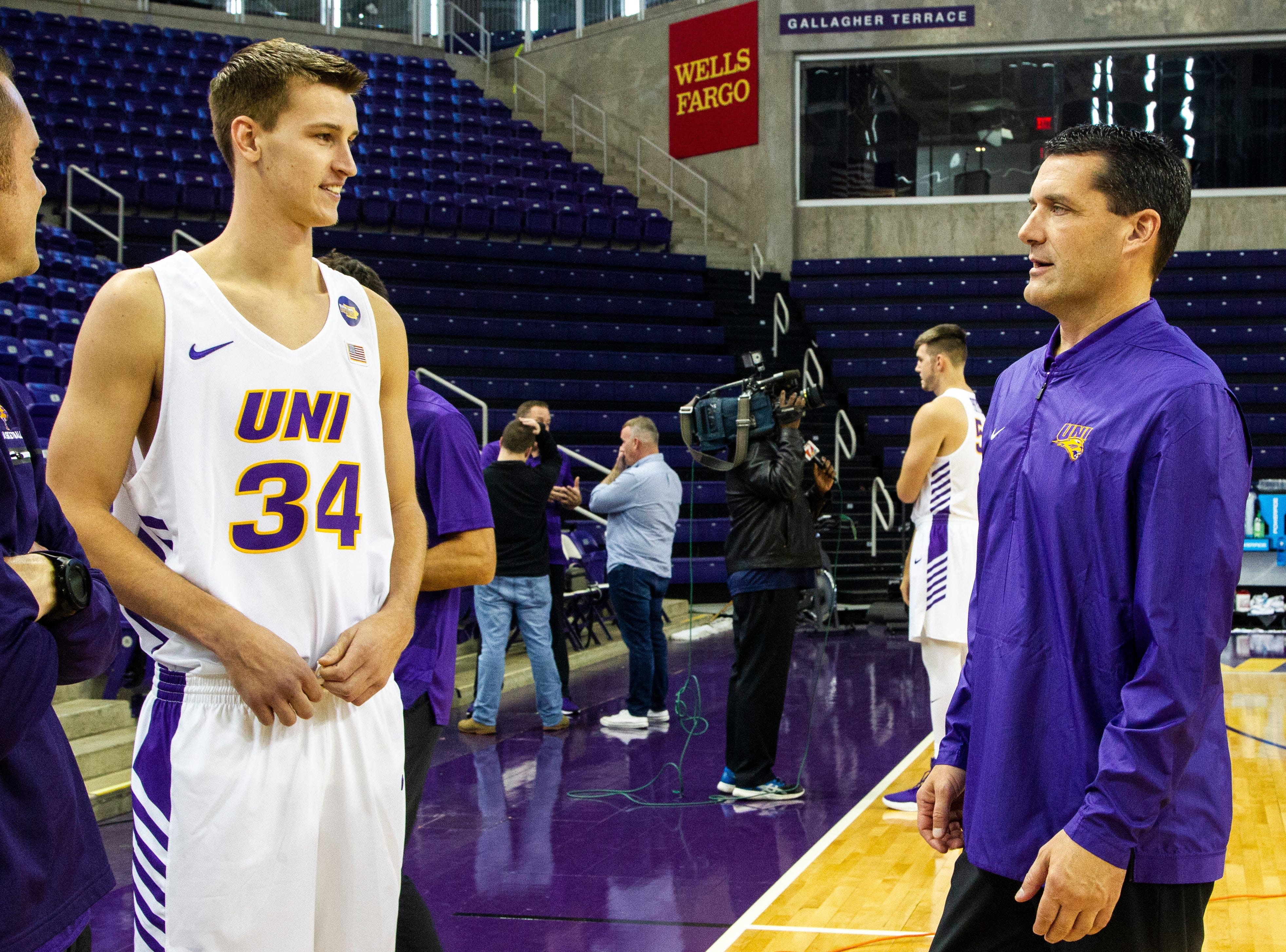 Northern Iowa forward Luke McDonnell (34) talks with head coach Ben Jacobson during Panthers men's basketball media day on Wednesday, Oct. 17, 2018, at the McLeod Center in Cedar Falls.