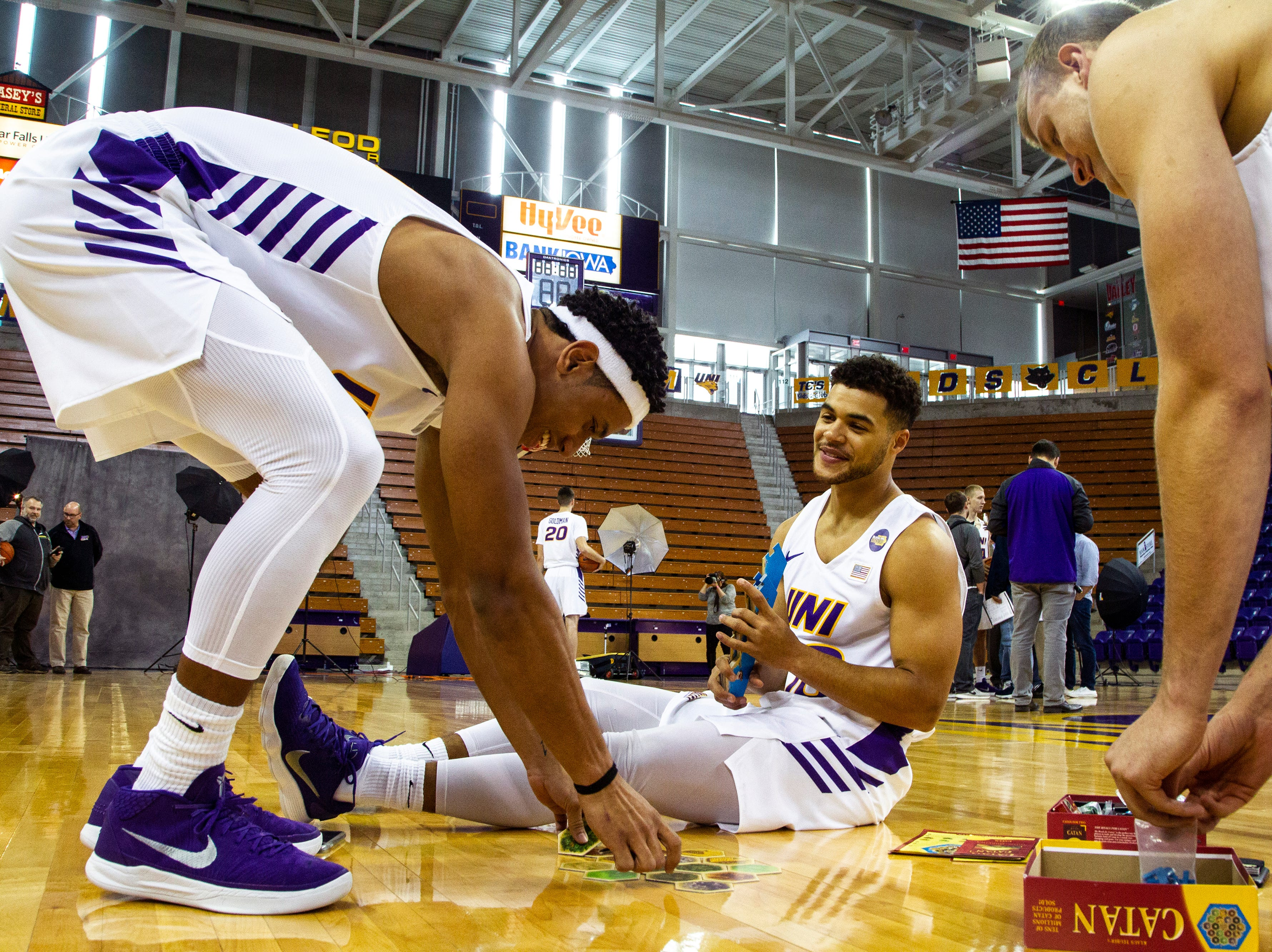 Northern Iowa guard Trae Berhow (11) Miles Wentzien (10) and Justin Dahl (15) play the Settlers of Catan board game during Panthers men's basketball media day on Wednesday, Oct. 17, 2018, at the McLeod Center in Cedar Falls.