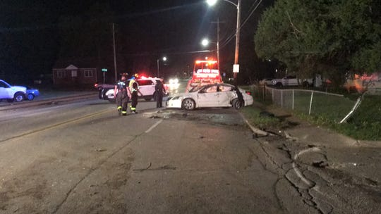 A white Nissan in the middle of Douglas Avenue after its driver lost control and struck another car and utility pole Tuesday, Oct. 16, 2018.