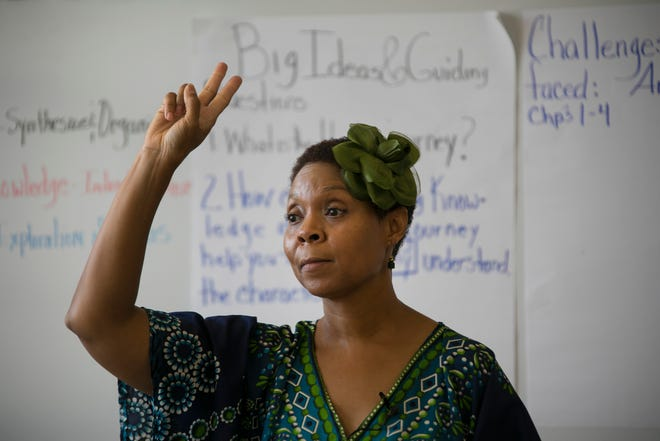 Felecia Branch does a count to settle her class down as she teaches a sixth grade class at Mackenzie Elementary-Middle School in Detroit Monday, Sept. 17, 2018.