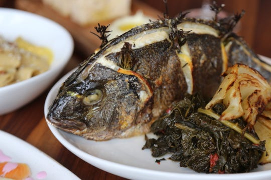 Whole-roasted Mediterranean sea bream ($42) with braised greens and roasted fennel from SheWolf Pastificio & Bar in Detroit's Cass Corridor/Midtown neighborhood.