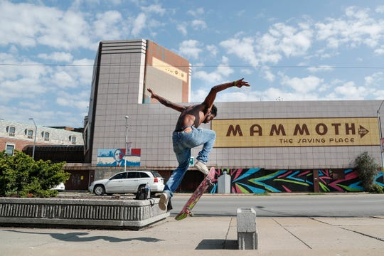 CJ Johnson of Detroit makes a jump with his skateboard across the street of the Mammoth Shopping Center in Detroit on Tuesday, October 9, 2018.