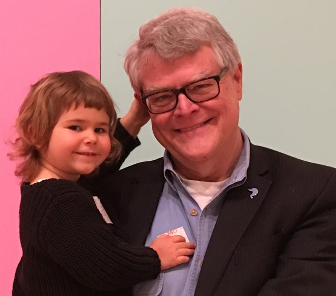 Dr. Randy Hillard with his three-year-old granddaughter, Remy.