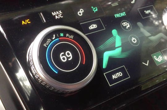Cabin temperature, fan speed and heated and cooled front seats are all controlled by just two dials: one for the driver, the other for the passenger. In a finger ballet that's nearly impossible without taking your eyes off the road, you adjust temperature by rotating the dial; fan by pushing the dial in a fraction of an inch and rotating; and seat temperature by pulling the dial out that same smidgeon and rotating.