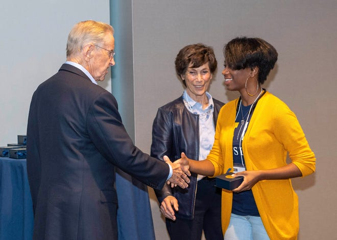 Fred Wilpon shakes hands with  Alana Burke of Detroit, a first year University of Michigan student and Kessler scholar. Watching is Judy Wilpon. This is during the Kessler Scholars welcome reception and dinner on September 21, 2018 in Ann Arbor.