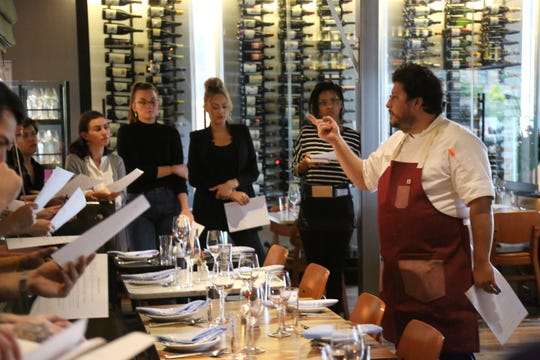Chef Anthony Lombardo addresses his front-of-house staff before dinner service at SheWolf Pastificio & Bar in Detroit's Cass Corridor/Midtown neighborhood.