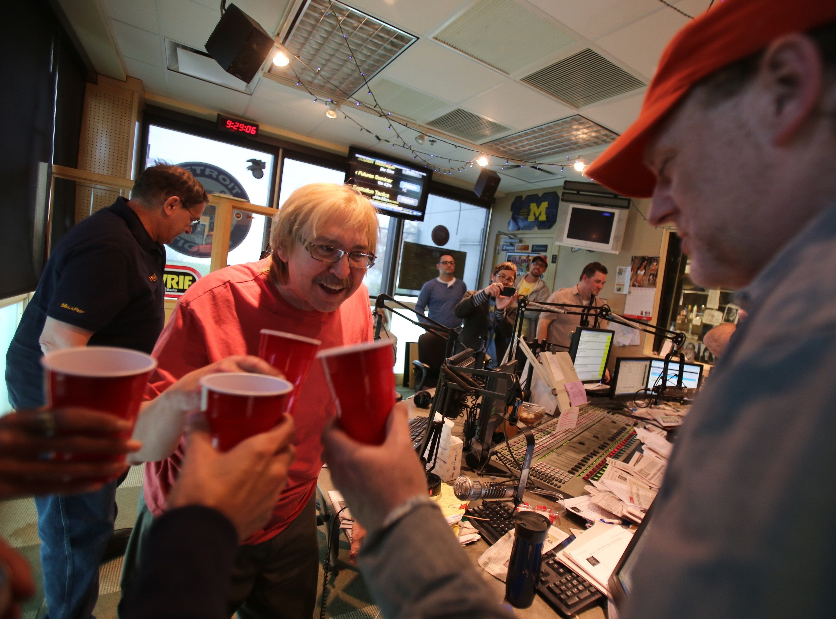 Mike Clark, left and Drew Lane of the Drew and Lane show toast a shot during a break on their last show on WRIF-FM, Friday May 17, 2013 in Ferndale.