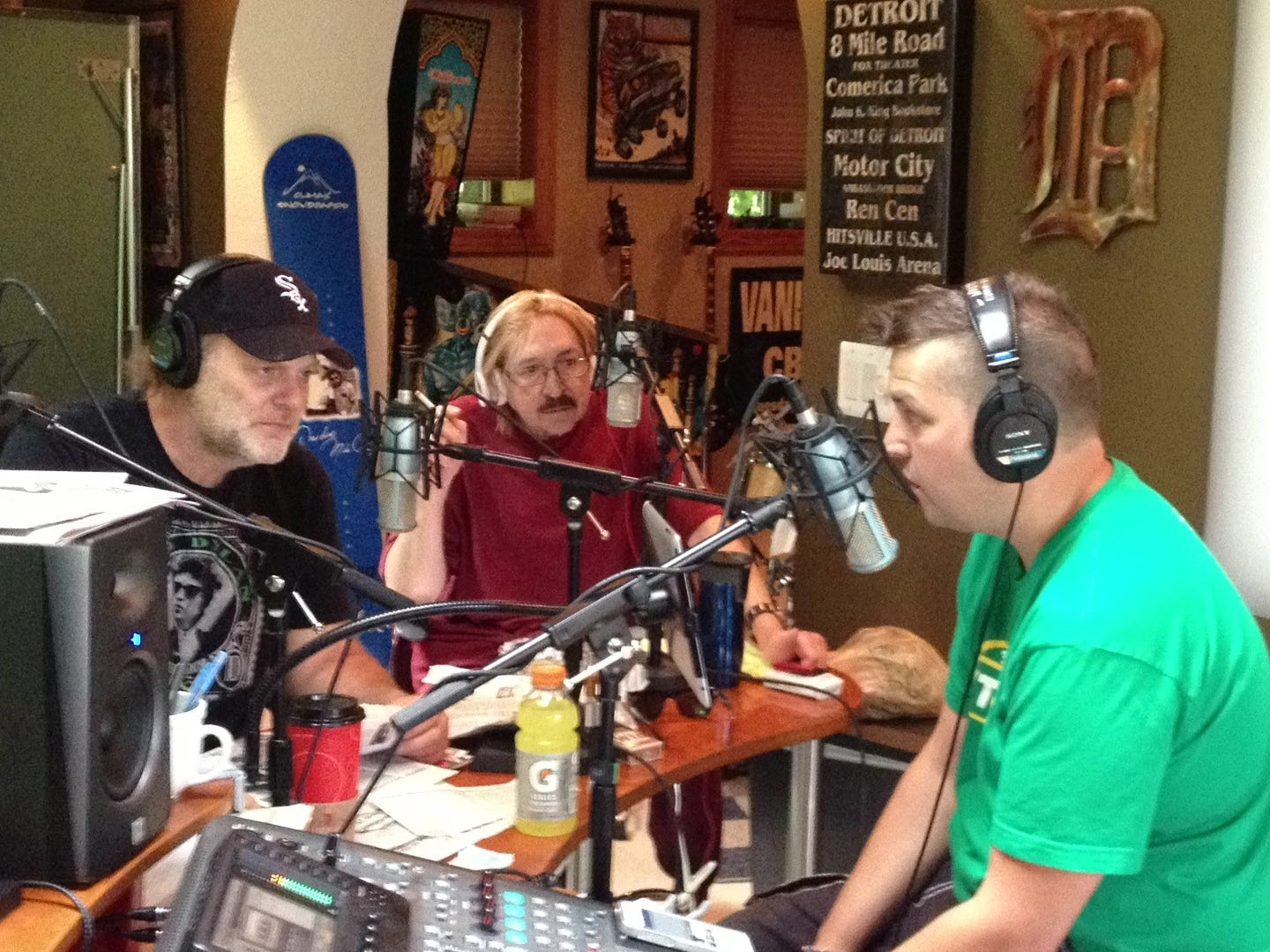 "Mike Clark (middle) joins his former WRIF-FM (101.1) partner Drew Lane (left) during Monday's 10th ""Drewcast"" podcast. Drew Lane — and longtime ""Drew and Mike"" producers Mike Wolters (right) and Marc Fellhauer — debuted their new podcast June 28."
