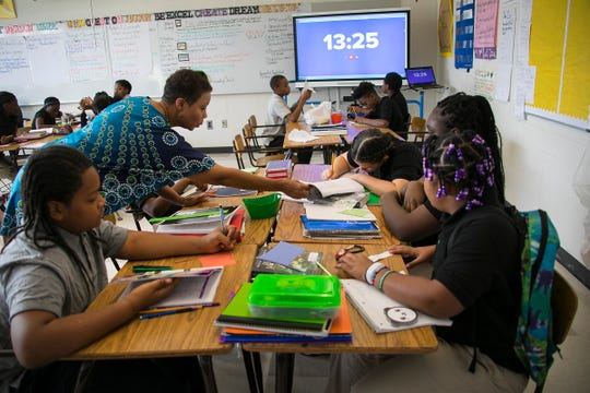 Felecia Branch teaches her first hour sixth grade class at Mackenzie Elementary-Middle School in Detroit Monday, Sept. 17, 2018.