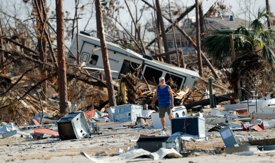 Ronnie Poole checks on a friend's home in Mexico Beach, Fla., in the aftermath of Hurricane Michael, one of 2018's hurricanes to hit the U.S.