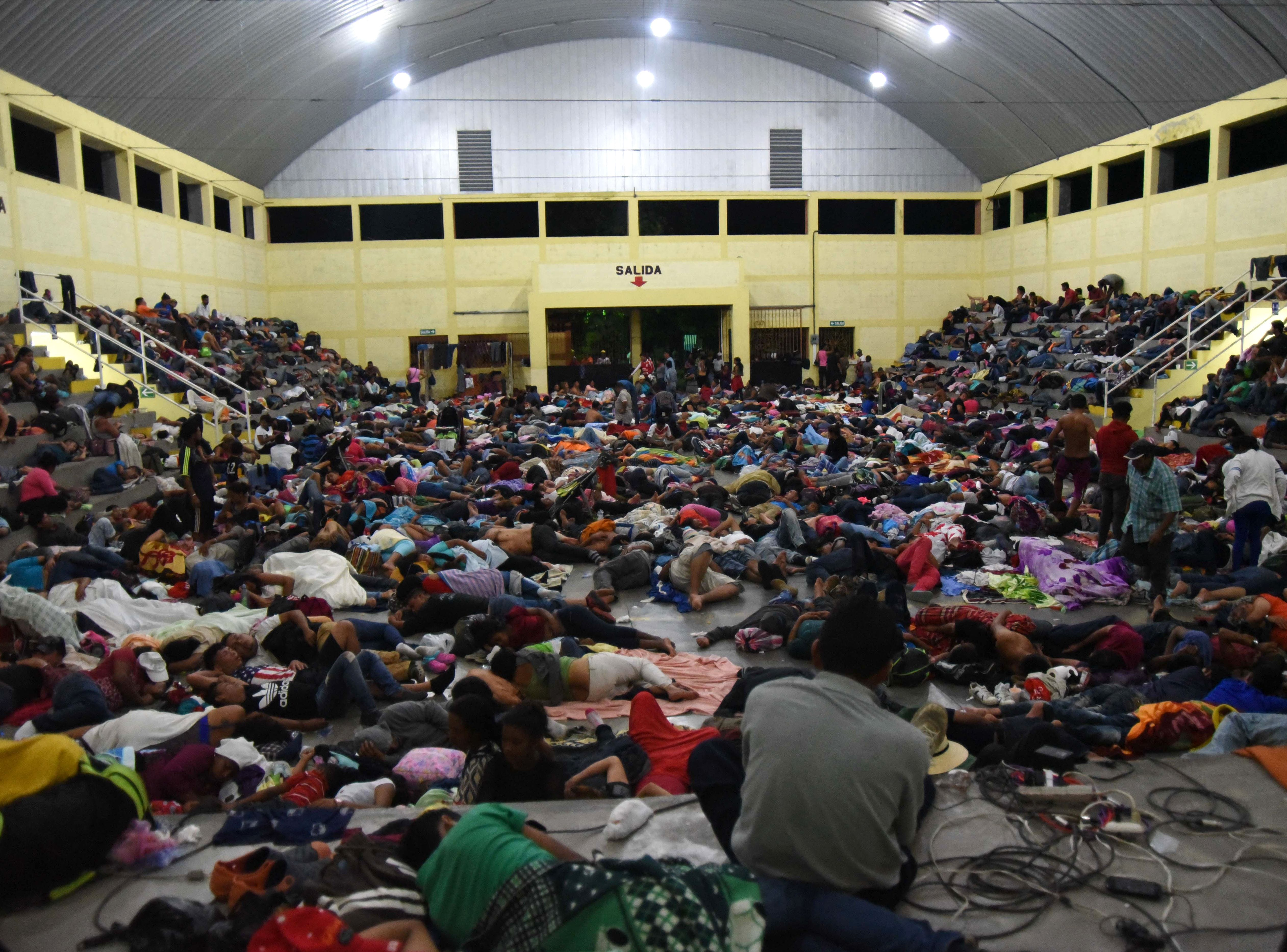 Honduran migrants heading to the United States rest in the gym of a Catholic church in Chiquimula, Guatemala, on Oct. 16, 2018. President Donald Trump warned Honduras he will cut millions of dollars in aid if the group of about 2,000 migrants is allowed to reach the United States.