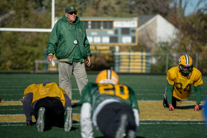 Coach John Herrington watches over practice at Farmington Hills Harrison on Wednesday.