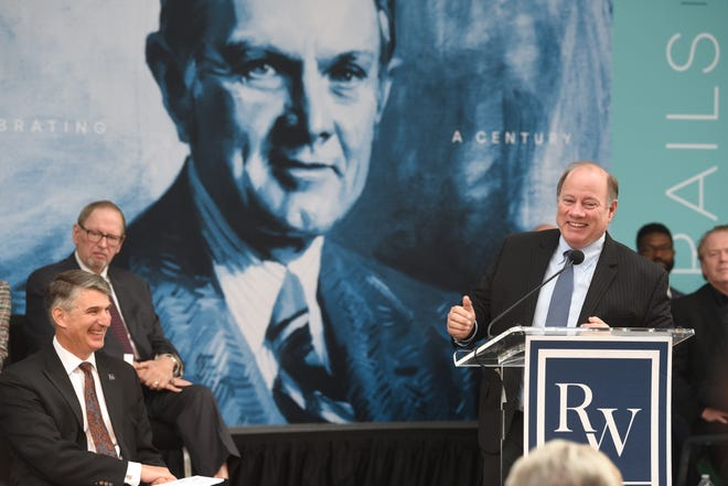 Mayor Mike Duggan talks about the $100 million donation from the Ralph C. Wilson Jr. Foundation, including the development of 22 acres at West Riverfront Park, during a ceremony in Detroit Wednesday.  A backdrop features a portrait of Wilson.  At left is the foundation's president, David Egner.     Max Ortiz, The Detroit News