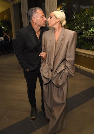 Christian Carino, left, and Lady Gaga are engaged.