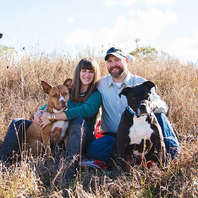 Rachel Peterson and her husband Robby with their rescue dogs Hector and Dikta at their home in Ionia.