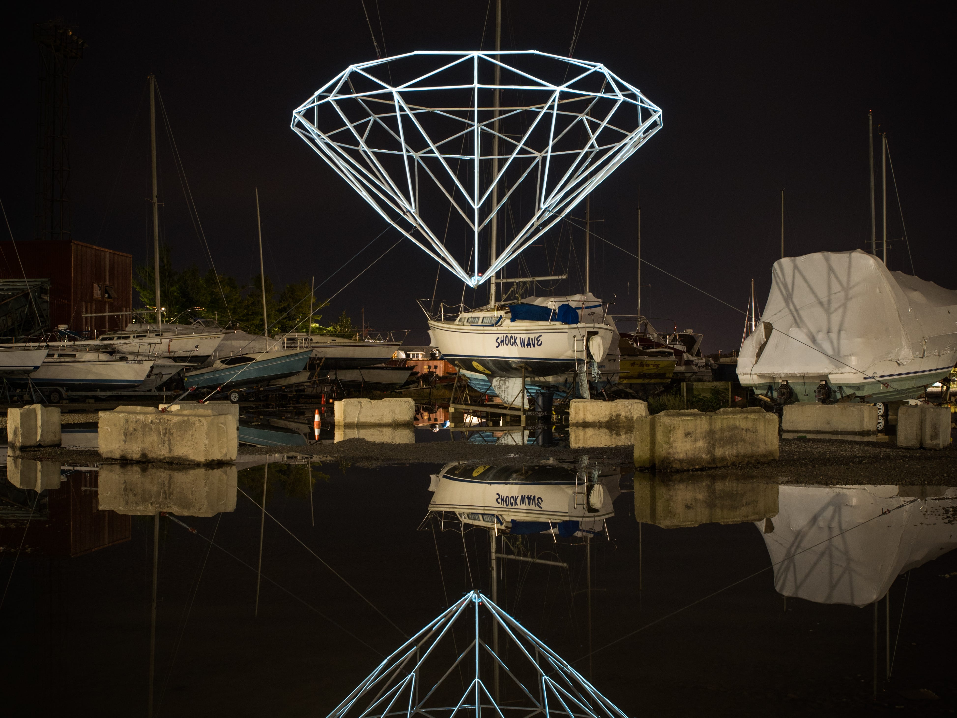 """The diamond-shaped light installation reflects into the waterfront site. """"It's about questions of value,"""" says artist Steve Coy.  """"We're negotiating with the idea of superficial value, real value, what does it mean to be human and why are we attracted to the things we are."""""""