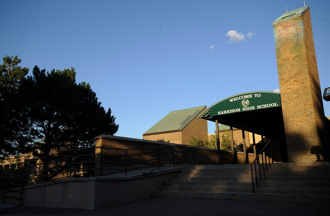 A Farmington Harrison High School official is on paid leave after saying the high school's cheer team looked like strippers at a pep rally performance.