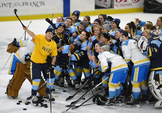 """National Women's Hockey League All-Star players take time for a """"selfie."""