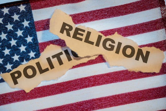 The Word Religion Laying Over The Word Politics On An American Flag