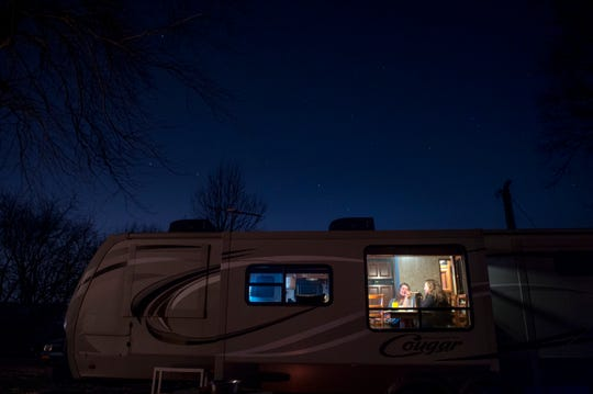 """At the end of the night, Valerie Hufford and Cathy Cobb-Gish chat in Valerie's RV on Dec. 9, 2017. Even in the winter months, the self-proclaimed """"River Rats"""" love escaping the city and spending time in their camps."""