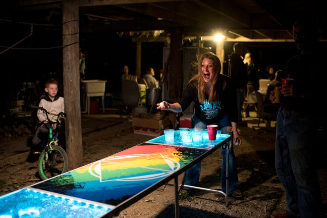 Valerie Hufford plays beer pong at a birthday party for her friend at the riverbank in Dade, Ky., on Oct. 21, 2017. Parties are frequent at the river, and often birthdays are celebrated communally.